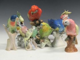 A collection of Royal Dux, Goebel and Karl Ens bird parrots and cockatoos, tallest 32cm high