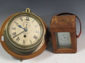 A cased carriage clock and a ships barometer 'Kelvin Bottomly - Glasgow'Provenance:Landwade Hall,