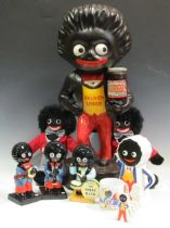 A large Robertson's Golden Shred advertising figure and a collection of other 'Golly' figures,
