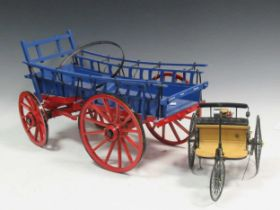 A wooden model of a cart and a miniature model of a triycleProvenance:Landwade Hall, Exning,
