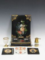 A Victorian papier-mache desk set, two silhouettes, a miniature miners lamp and a gilt metal mounted
