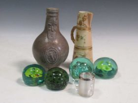 A silver mounted glass decanter, a silver mounted match striker, A bellarmine jar with restored
