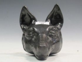 A cast iron doorstop modelled as a fox 16cm high together with another cast as a basket of