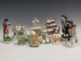 A collection of Staffordshire pottery to include pastille burners and figures