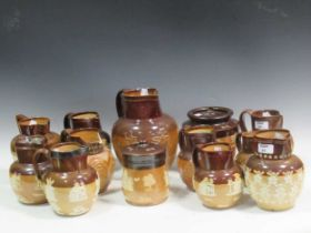 A good collection of Doulton saltglazed stoneware jugs (qty)