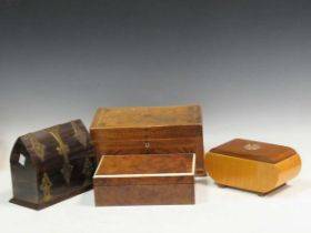 A coromandel casket, two work boxes, and a wooden box with a roulette wheel inset to the