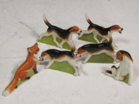 A set of Royal Worcester menu holders of a fox and hounds (6)Provenance:Landwade Hall, Exning,