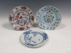 A 18th century Delft polychrome plate and two Chinese plates (3)