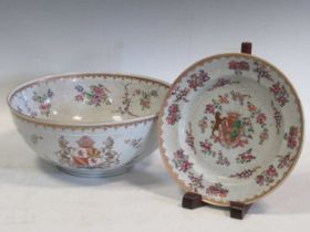 A Sampson famille rose armorial punch bowl, decorated in 18th century Chinese style, 29cm