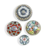 A group of four glass paperweights,
