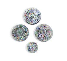 Four John Deacons millefiori glass paperweights