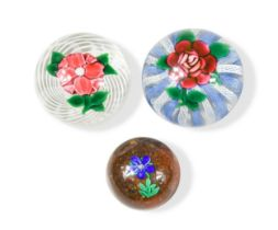 Attributed to Paul Ysart, three lampwork glass paperweights,