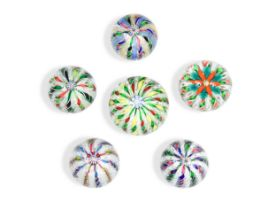 Five glass paperweights, probably by John Deacons,