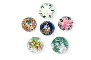 A group of six Lundberg Studio paperweights,