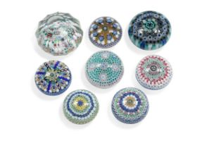 Eight Jim Brown millefiori glass paperweights,