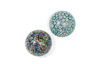 Two John Deacons magnum paperweights,