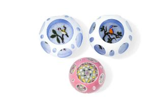 Three John Deacons facet cut double overlay glass paperweights,