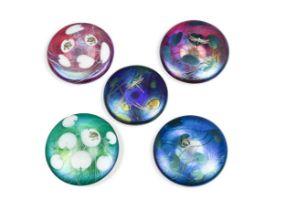 Five John Ditchfield iridescent glass paperweights,