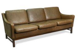 A modern brown leather three-seat sofa,
