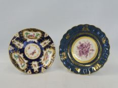 "A Royal Worcester bowl, blue and gilded border with central mauve floral spray, 7 3/4"" diameter,"