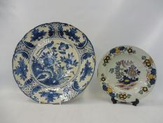 "An 18th Century Delft tin glazed blue and white charger, 13 1/4"" diameter, plus a small Delft"