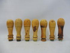 A set of seven Victorian ivory handles of good colour.