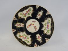 A Royal Worcester cabinet plate 'Old Worcester Scale Blue', painted with exotic birds, bearing paper