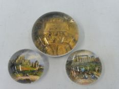 Three collectable glass paperweights including Dover Castle.