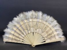 An ivory 16 section fan with embroidered silk and feathers.