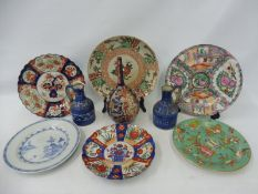 A collection of mostly 19th Century Oriental ceramics including an Imari bottle vase.