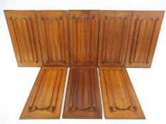 "A set of eight 19th Century decorative carved oak linen fold panels, each 8 1/4 x 16 3/4""."