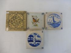 Three early Delft tiles plus one other, possibly Minton.
