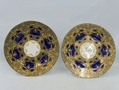 Two very similar high quality Royal Worcester cabinet plates of cobalt blue ground overlaid with