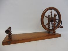 "A 19th Century decorative fruitwood table wool winder, 19 1/4 x 6""."