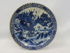 An 18th Century Chinese circular charger with a busy town scene, with figures and animals, set