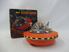 A boxed circa 1960s flying saucer with space pilot, made in Japan, in untested condition.