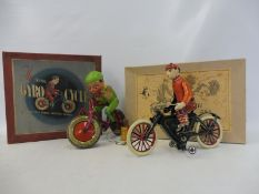 A boxed Tri-ang Gyro-Cycle and a boxed German 'Rolli 230' tinplate bicycle.