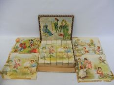 A wooden boxed set of puzzle blocks with pictures.