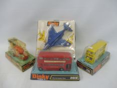 Four circa 1970s boxed Dinky Toys, to include the F4K Phantom, Routemaster bus, the Aveling Roller