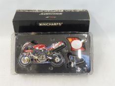 A boxed Minichamps 1:12th scale Ducati 996 Superbike.
