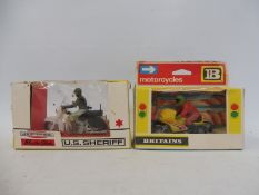 Two boxed Britains motorcycles, US Sheriff Harley Davidson and Moto Cyclette.