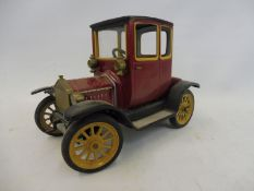 A Schuco 'Ford' tinplate clockwork car, no. 1227.