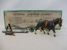 An original Britains general purpose plough, with horses and original box, no. 6F.
