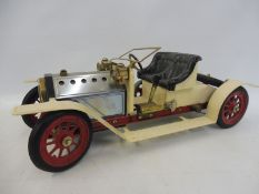A Mamod 'Steam Roadster' live steam model of an Edwardian motor car.
