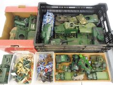 A collection of assorted plastic military figures, vehicles and magazines etc.