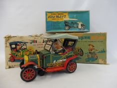 A boxed Japanese tinplate battery operated 'Jake the Shake' and an empty box for 'Bubble Blowing