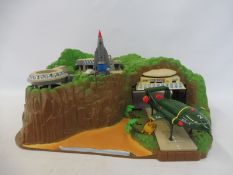 A Tracy Island plastic set with three models.