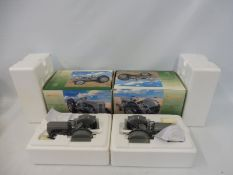 Two boxed Universal Hobbies Massey Ferguson 1:16th scale tractors.