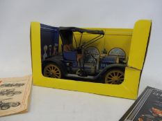 A Schuco 'Opel' tinplate clockwork car, no. 1228, with partial box and leaflet and key.