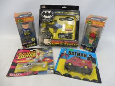 A selection of mainly Batman Superheroes to include an Ertl Batman Returns gift set, Ertl joker van,